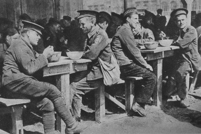 British Prisoners Of War Having A Meal In A Converted Shed