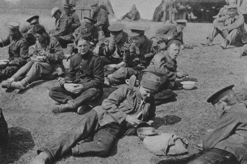 British Prisoners Eating A Meal In A Prisoner Of War Camp