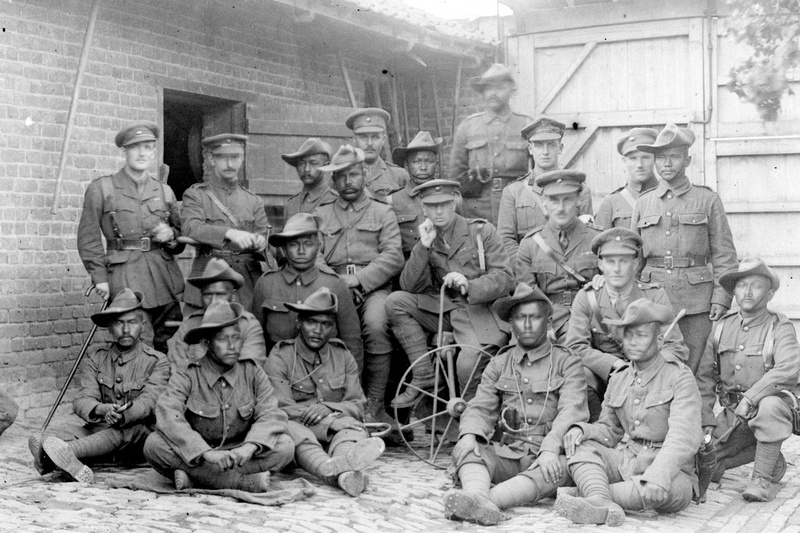 Group of British & Indian officers 1-4th Gurkhas in a French farm house