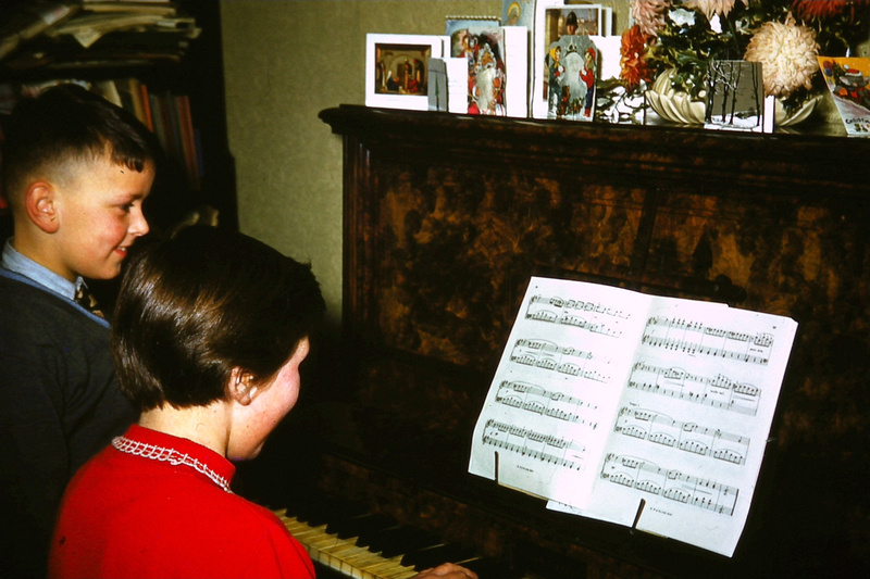 Playing The Piano At Christmas 1950s