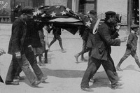 An American Victim Of The Lusitania Being Carried Through Queenstown His Body Covered With The Stars And Stripes