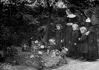 Village Children TendingThe Grave Of Major Wiliam Redmond Who Was Mortally Wounded At Messines Ridge And BuriesIn The Convent At Loecre