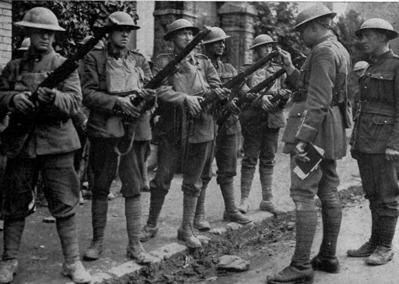 A Canadian Officer Inspecting Mens Rifles