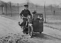 A Motor Cycle And Machine Gun Side Car
