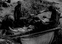 A Battalion Orderly Room Attending To Daily Correspondence In A Shell Crater