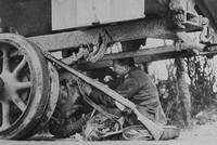 An Army Service Corps Motor-Man Repairing A Breakdown On The Road
